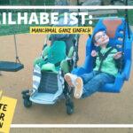 oto eines strahlenden kleinen Jungen, der in einer Schaukel für Kinder mit Behinderung sitzt. Neben ihm steht sein Reha-Buggy. Die Überschrift dazu lautet: Teilhabe ist: Schwer zu kriegen.